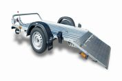Trailers for transporting goods with loading ramps
